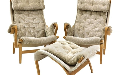 A pair of 'Pernilla 69' lounge chairs and an ottoman