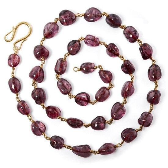 A spinel necklace, India, with thirty-seven polished spinels, each weighing between 12-15 carats, with gold wire links and gold hook clasp, 72cm. long, weight 93.4 grams (including the 23.5 carat gold wire) Mughal emperors have had, for centuries...