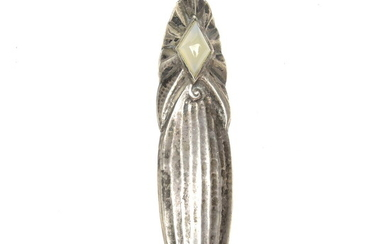 Hammered silver brooch with diamond shaped moonstone, design & execution...