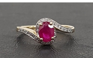 RUBY AND DIAMOND RING the central oval cut ruby approximatel...
