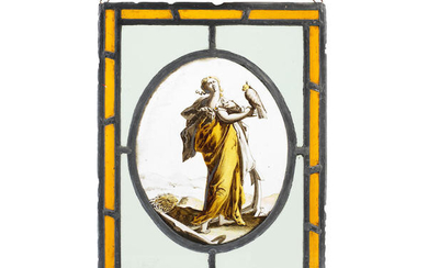 A 17th century and later Flemish stained glass panel depicting a maiden with a hawk, possibly an allegory of Hope after an engraving by Hendrick Goltzius (Dutch, 1558-1617)