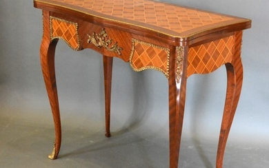 A French Inlaid and Gilt Metal Mounted Card Table of serpent...