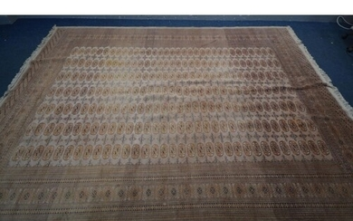 A WOOLLEN RUSSET TEKKE CARPET SQUARE, with a multi strap bor...
