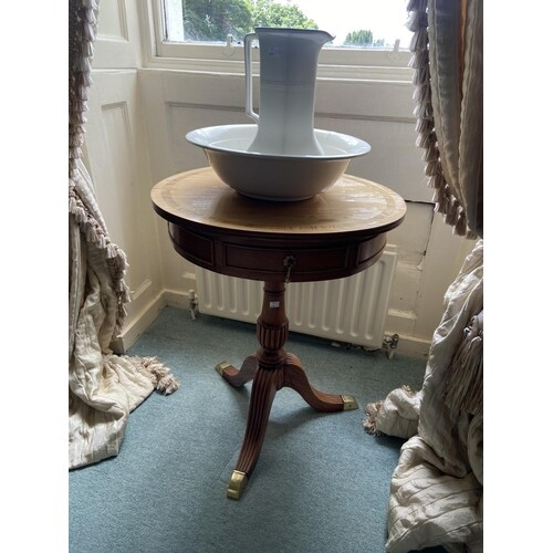 A circular Regency style mahogany rosewood banded Occasional...
