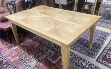 A contemporary inlaid oak extending dining table, 236cm exte...