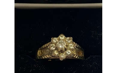 A diamond cluster ring, set in yellow gold (shank cut)