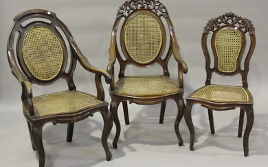 A near pair of late 19th/early 20th century hardwood framed bergère elbow chairs with double-ca