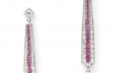A pair of 14 karat white gold diamond, ruby and agate earrings. Long pair of earrings of tapered design, set with diamonds, carré cut rubies and a briolette cut green agate suspending. One brilliant cut diamond of ca. 0.10 ct., ca. F-G, ca. VS is set...