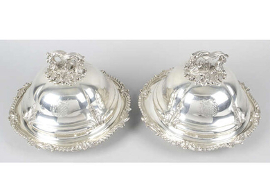 A pair of early Victorian silver vegetable dishes and covers.