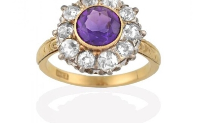 An Amethyst and Diamond Cluster Ring, the round cut amethyst...