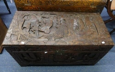 An Oriental camphorwood Chest, with carved decoration of an ...