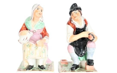 Pair of Seated Porcelain Figures, Man and Woman
