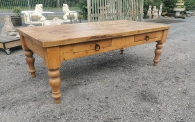 20th C. Pine table with two drawers in the frieze raised on ...