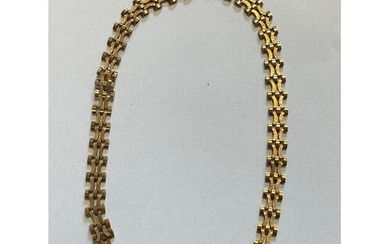 A 9ct gold collar necklace, composed of textured articulated...