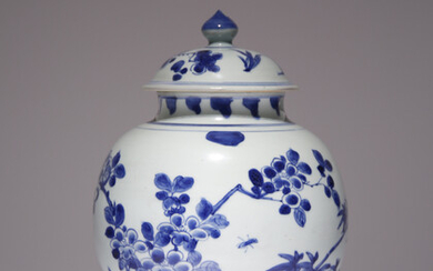A CHINESE BLUE AND WHITE BALUSTER VASE AND COVER