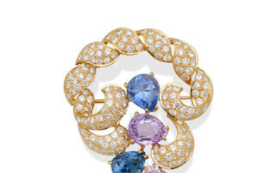 A COLOURED SAPPHIRE AND DIAMOND BROOCH