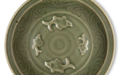 A Chinese Longquan celadon 'fish' dish, Ming dynasty, the interior decorated with four moulded fish surrounded by a band of incised waves, 32.4cm diameter, with wood stand