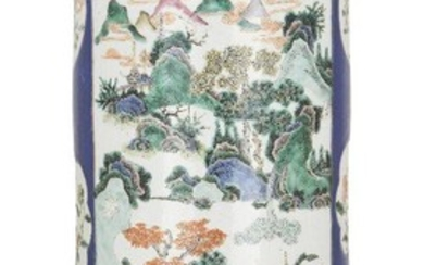A Chinese porcelain cylindrical famille verte stick stand, 19th century, decorated with two large panels, one painted with a landscape, the other with flowers and rockwork, interspersed with six smaller panels of flowers and mythical beasts, all on...