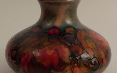 A Moorcroft squat vase, decorated in the Leaf and Berry patt...