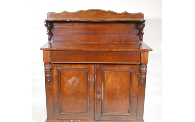 A Victorian mahogany chiffonier, with shaped back and single...