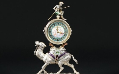 A Viennese silver table clock with rock crystal case