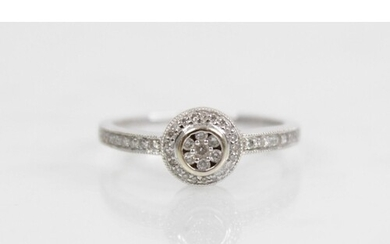 A diamond 18ct gold halo cluster ring, designed as a central...