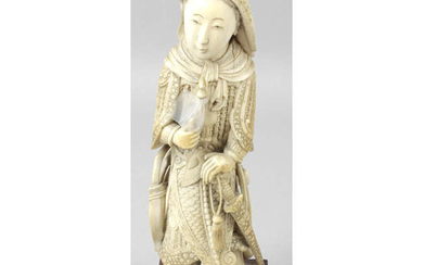 A late 19th century oriental carved ivory figure