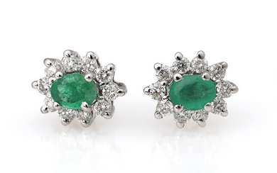 NOT SOLD. A pair of emerald and diamond ear studs each set with an emerald...