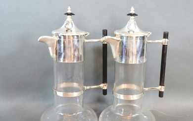 A pair silver plated and glass claret jugs in the style of C...