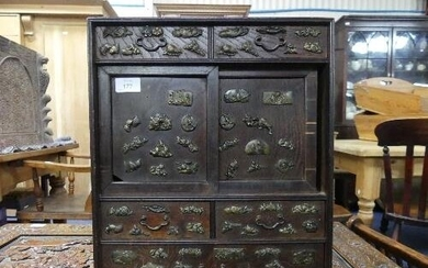 An early 20thC Japanese oak Table Top Cabinet, with a pair o...