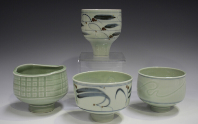Four Derek Clarkson studio porcelain footed bowls, each decorated with a celadon glaze, two with cob