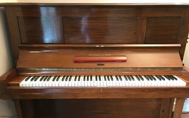 Steinway (c1928) A Model K upright piano in a rosewood case.