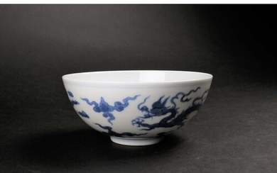 A Chinese blue 7 white dragon bowl, Republic period, painted...