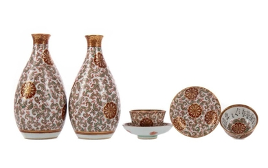 A PAIR OF JAPANESE KUTANI SAKI BOTTLES AND A PAIR OF MATCHING BOWLS ON STANDS