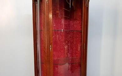 A Transitional style mahogany veneered glass cabinet with ormolu decoration,...
