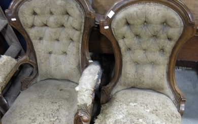 A Victorian walnut grandfather and grandmother chair, spoon ...