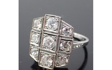 A diamond cluster ring set in 18ct gold finger size L