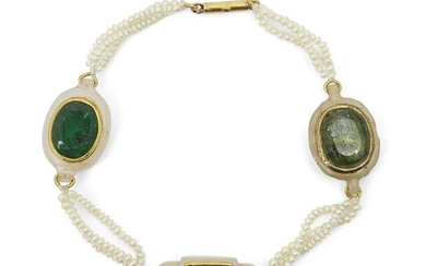 A gem-set jade and seed pearl bracelet, India, late 19th century, with three jade elements set with stones in gold surrounds, attached to each other with three strands of seed pearls, 20cm. long