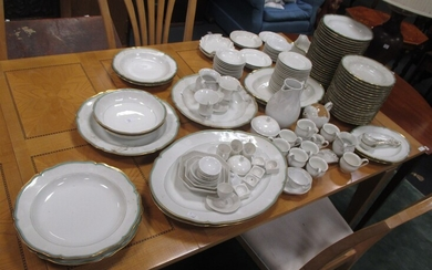 A large dinner service made in Berlin consisting of 58 Dinner plates, 11 Soup plates, 1 soup