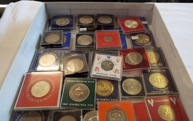 A large selection of crowns and coins in Perspex cases to in...