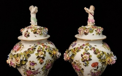 A pair of 20th Century vase and covers each decorated with g...
