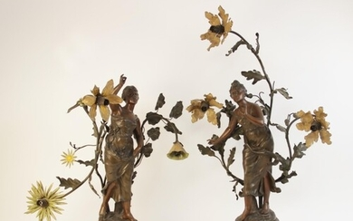 A pair of French Art Nouveau spelter figural table lamps, ti...