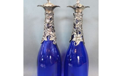 A pair silver plated and blue glass decanters, decorated wit...