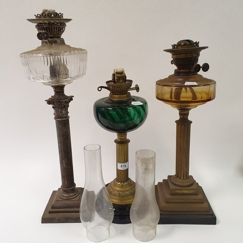 A silver plated oil lamp, with a clear glass well, base in t...
