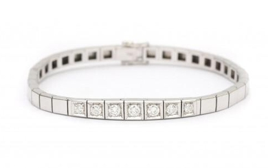 An 18 carat white gold diamond bracelet. Featuring a flat bracelet with rectangular densly aligned links to an integrated clasp with safety eye. The center part of the bracelet is set with seven brilliant cut diamonds of ca. 0.51 ct. total, ca. F-G...