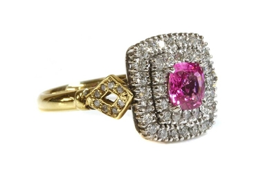 An 18ct gold pink sapphire and diamond cushion-shaped halo cluster ring