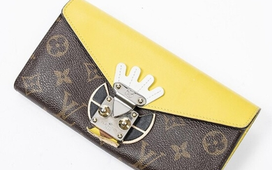 """Louis Vuitton: A """"Jaune Tribal Mask Sarah Wallet"""" of brown mongoram canvas and yellow leather with gold and silver tone hardware. – Bruun Rasmussen Auctioneers of Fine Art"""