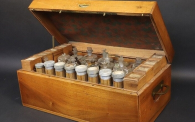 Field pharmacy by Cadet, the Emperor's pharmacist, Rue Saint-Honoré 108. Varnished walnut case opening on the top and front panel on three drawers. Upper part offering eight mobile wooden racks with lids on slides, eight pewter jars with lids and a...