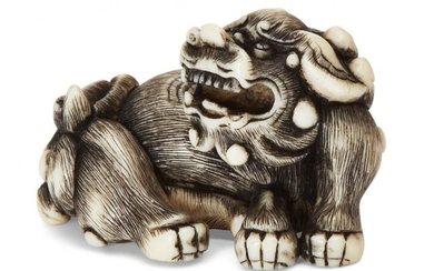Property of a Gentleman (lots 36-85) A Japanese Ivory Netsuke, 18th century, finely carved as a recumbent shishi with open mouth, 4cm