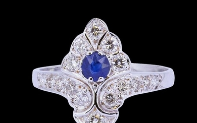 SAPPHIRE AND DIAMOND DRESS RING, set with a blue sapphire of...